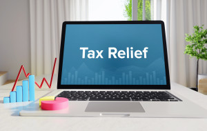 Tax Relief – Statistics/Business. Laptop in the office with term on the display. Finance/Economics.